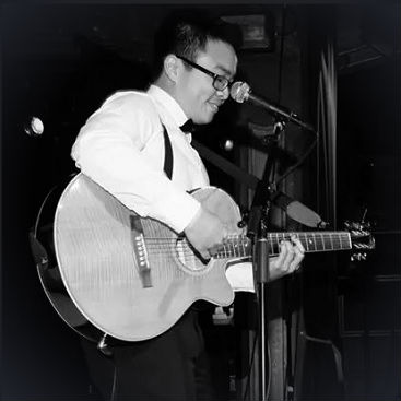 Dr. Dinh playing guitar